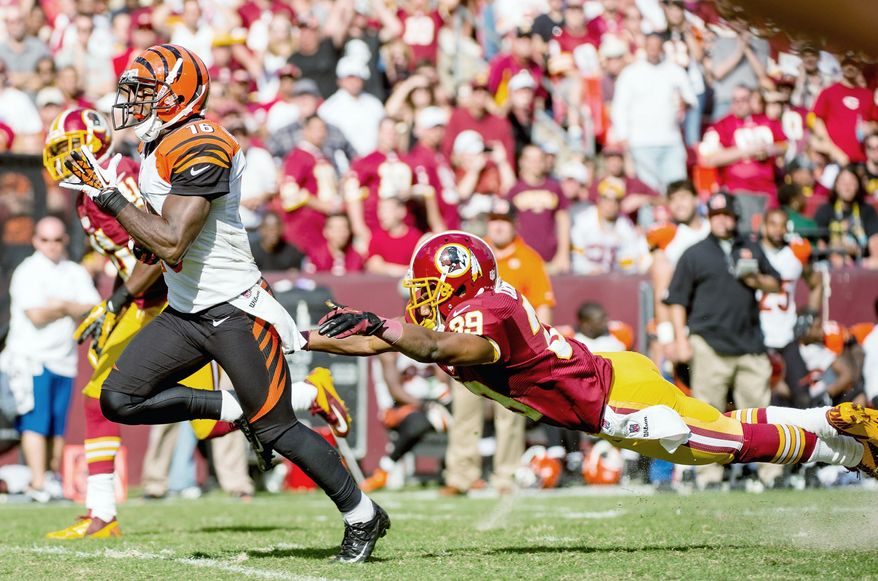 Redskins cornerback Richard Crawford lunges to no avail as Bengals wide receiver Andrew Hawkins scores on a 59-yard touchdown. The play put Cincinnati up by two touchdowns. (Andrew Harnik/The Washington Times)