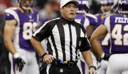 Referee Ken Roan shown during the first half of an NFL football game between the Minnesota Vikings and the San Francisco 49ers Sunday, Sept. 23, 2012, in Minneapolis. (AP Photo/Genevieve Ross)