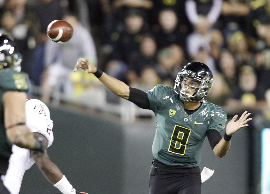 Oregon quarterback Marcus Mariota unleashes a pass during the first half of their NCAA college football game against Arizona  in Eugene, Ore., Saturday, Sept. 22, 2012. (AP Photo/Don Ryan)