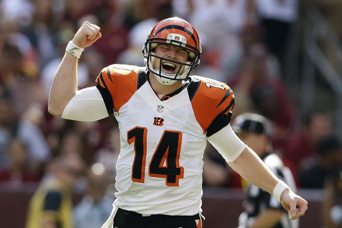 Cincinnati Bengals quarterback Andy Dalton reacts to a touchdown pass to wide receiver Andrew Hawkins during the second half of an NFL football game against the Washington Redskins in Landover, Md., Sunday, Sept. 23, 2012. The Bengals defeated the Redskins 38 - 31.(AP Photo/Alex Brandon)