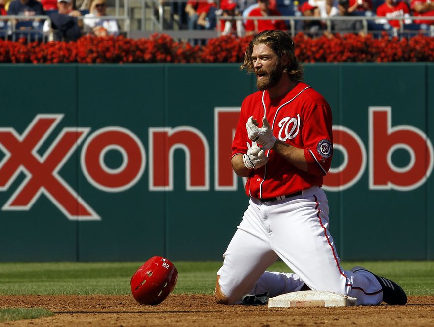 Washington Nationals' Jayson Werth kneels in the dirt after he was forced out at second by Milwaukee Brewers second baseman Rickie Weeks in a double play during the third inning of a baseball game in Washington, Sunday, Sept. 23, 2012. The Brewers beat the Nationals 6-2. (AP Photo/Ann Heisenfelt)