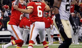 Kansas City Chiefs kicker Ryan Succop (6) celebrates his game-winning field goal with holder Dustin Colquitt (2) as New Orleans Saints cornerback Corey White (24) walks past in overtime of an NFL football game in New Orleans, Sunday, Sept. 23, 2012. The Chiefs won 27-24. (AP Photo/Jonathan Bachman)