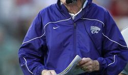 Kansas State coach Bill Snyder walks along the sidelines in the first quarter of an NCAA college football game against Oklahoma in Norman, Okla., Saturday, Sept. 22, 2012. (AP Photo/Sue Ogrocki)