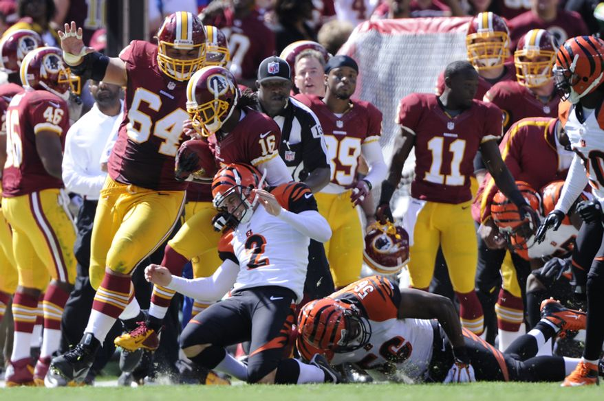 Washington Redskins wide receiver Brandon Banks (16) returns a kickoff 55 yards before being taken down by Cincinnati Bengals kicker Mike Nugent (2) in the second quarter at FedEx Field, Landover, Md., Sep. 23, 2012. (Preston Keres/Special to The Washington Times)