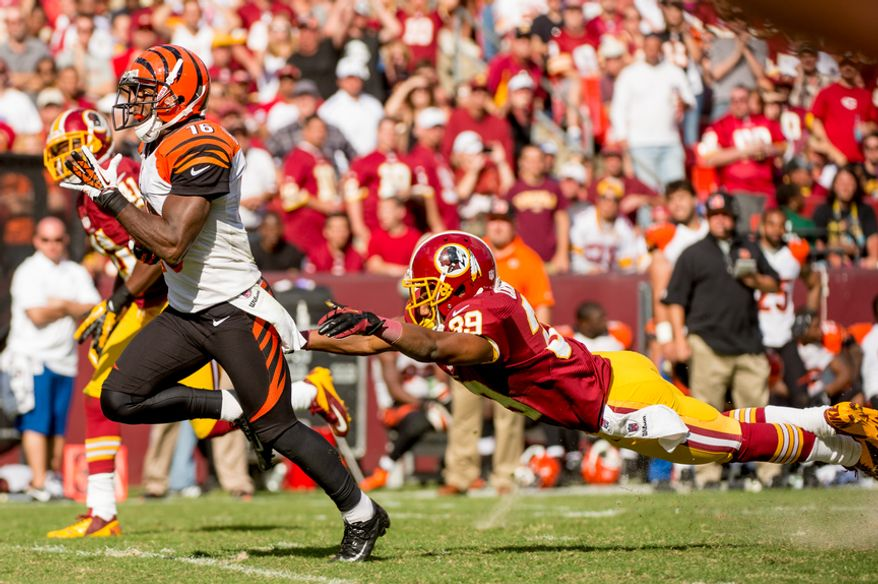 Washington Redskins cornerback Richard Crawford (39), right, can't stop Cincinnati Bengals wide receiver Andrew Hawkins (16) as he scores on a 59 yard touchdown to put the Cincinnati Bengals up 38-24 in the fourth quarter against the Washington Redskins on their home opener at FedEx Field, Landover, Md., Sunday, September 23, 2012. (Andrew Harnik/The Washington Times)