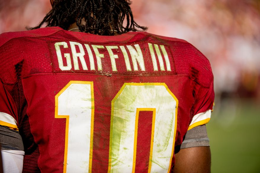 The jersey of Washington Redskins quarterback Robert Griffin III (10) is stained with grass and dirt in the fourth quarter as the Washington Redskins lose to the the Cincinnati Bengals 38-31 on their home opener at FedEx Field, Landover, Md., Sunday, September 23, 2012. (Andrew Harnik/The Washington Times)