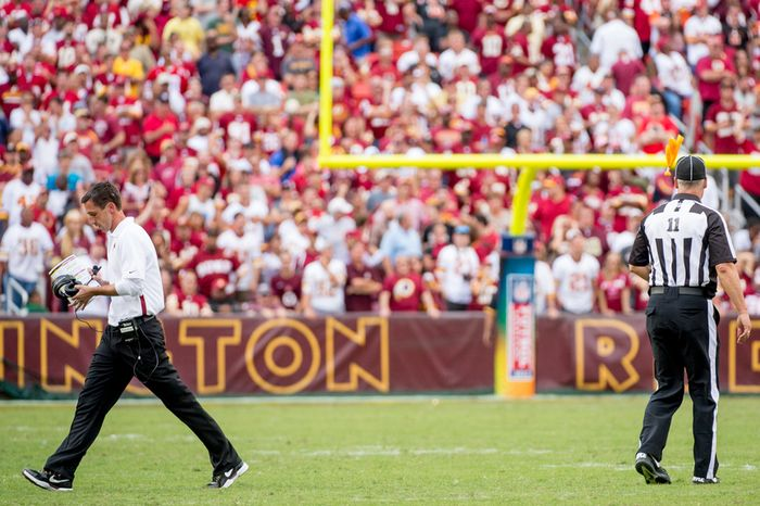 Washington Redskins offensive coach Kyle Shanahan walks off the field as a referee throws his flag for unsportsmanlike conduct late in the fourth quarter as the Washington Redskins play the Cincinnati Bengals on their home opener at FedEx Field, Landover, Md., Sunday, September 23, 2012.