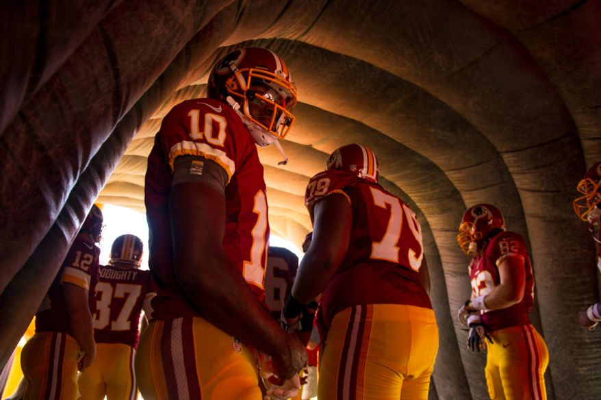 Washington Redskins quarterback Robert Griffin III (10) waits to be announced before the Washington Redskins play the Cincinnati Bengals on their home opener at FedEx Field, Landover, Md., Sunday, September 23, 2012. (Andrew Harnik/The Washington Times)