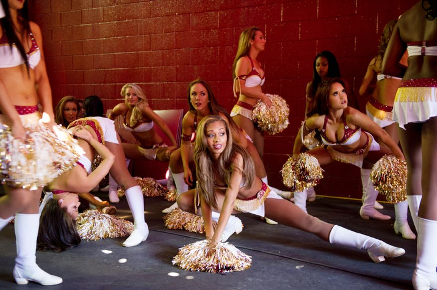 Washington Redskins cheerleaders warm up in the tunnel before the Washington Redskins lose to the Cincinnati Bengals 38-31 on their home opener. (Andrew Harnik/The Washington Times)
