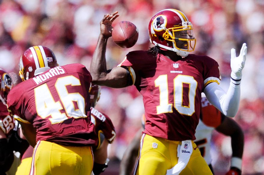 Washington Redskins quarterback Robert Griffin III (10) fumbles the ball, but goes on to recover it during the first quarter. (Preston Keres/Special to The Washington Times)