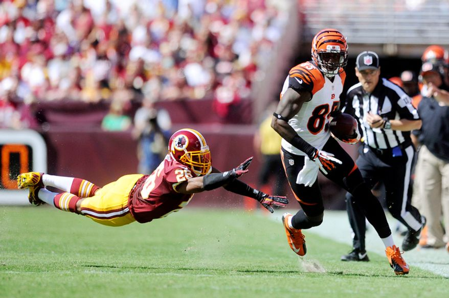Cincinnati Bengals wide receiver Armon Binns (85) turns upfield past Washington Redskins cornerback Josh Wilson (26) for a 48-yard touchdown in the first quarter. (Preston Keres/Special to The Washington Times)