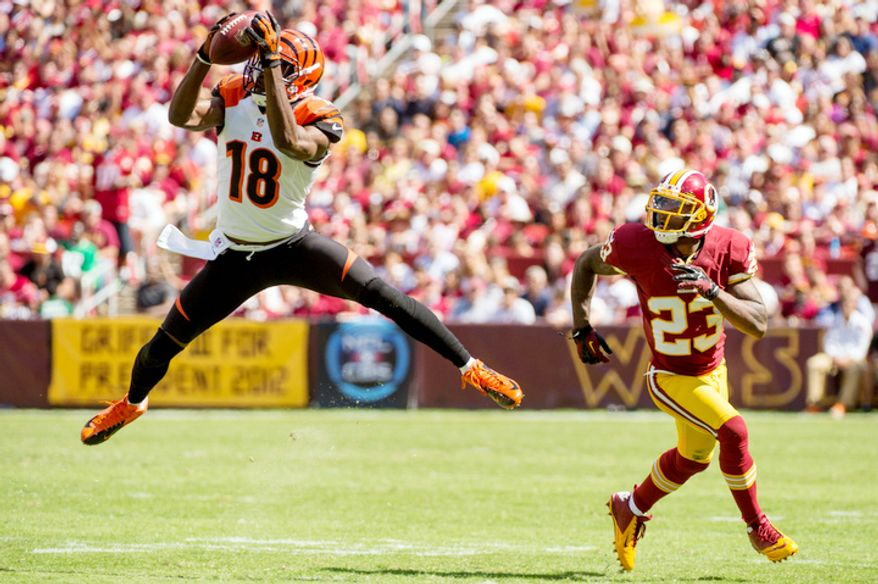 Cincinnati Bengals wide receiver A.J. Green (18) makes a 5 yard reception against Washington Redskins cornerback DeAngelo Hall (23) at the end of the first quarter. (Andrew Harnik/The Washington Times)