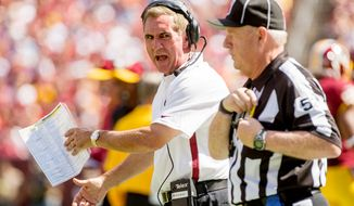 Washington Redskins head coach Mike Shanahan yells at a ref in the first half. (Andrew Harnik/The Washington Times)