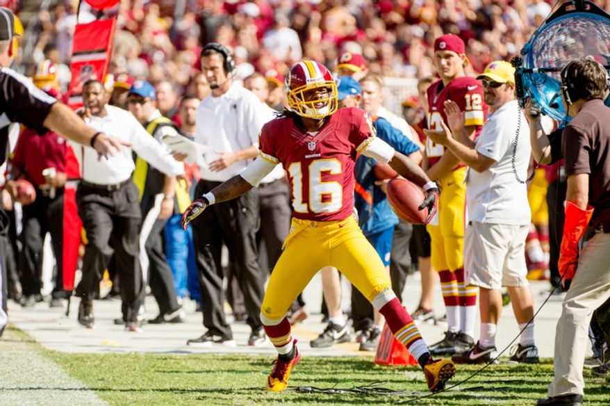 Washington Redskins wide receiver Brandon Banks (16) is pushed out of bounds after a 21 yard run in the third quarter. (Andrew Harnik/The Washington Times)