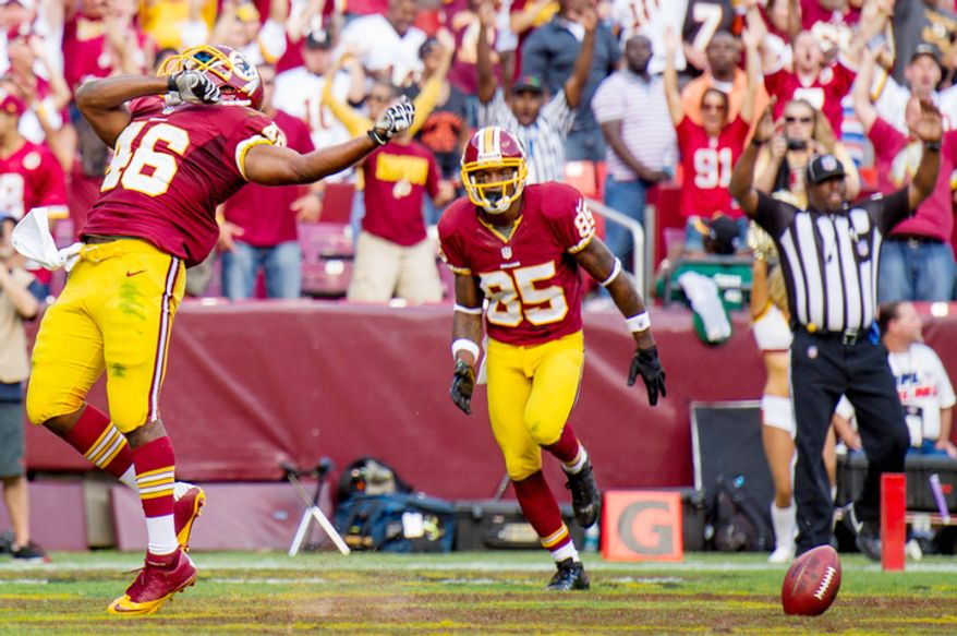 Washington Redskins running back Alfred Morris (46), left, celebrates a 7 yard touchdown in the third quarter. (Andrew Harnik/The Washington Times)