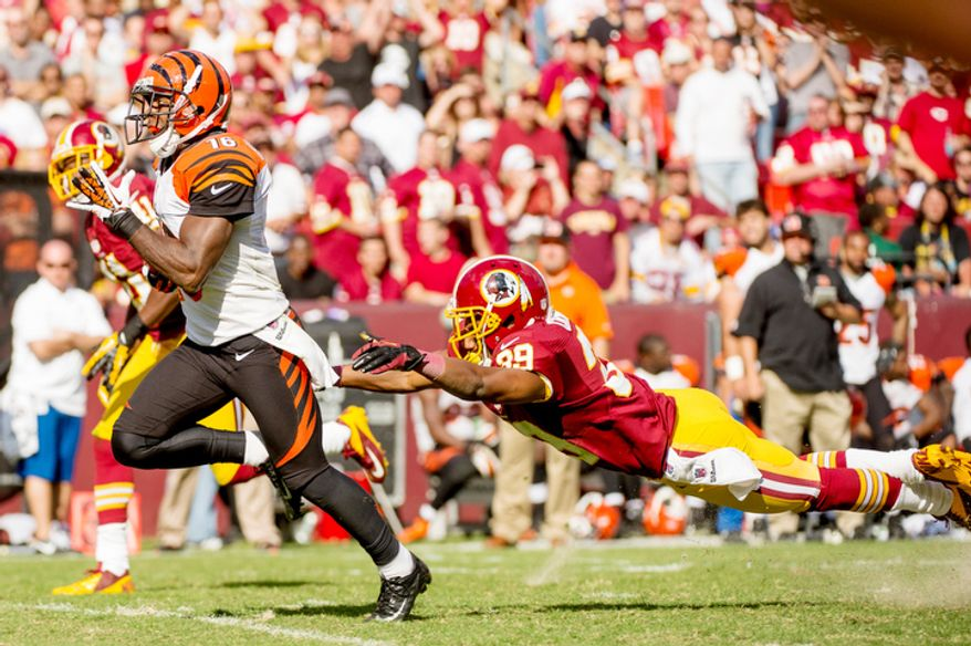 Washington Redskins cornerback Richard Crawford (39), right, can't stop Cincinnati Bengals wide receiver Andrew Hawkins (16) as he scores on a 59 yard touchdown to put the Cincinnati Bengals up 38-24 in the fourth quarter. (Andrew Harnik/The Washington Times)