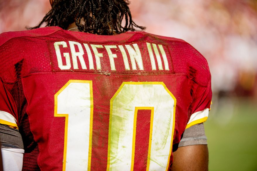 The jersey of Washington Redskins quarterback Robert Griffin III (10) is stained with grass and dirt in the fourth quarter. (Andrew Harnik/The Washington Times)