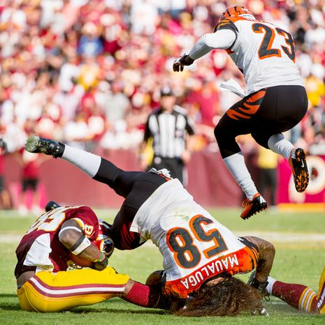 Washington Redskins wide receiver Leonard Hankerson (85) is injured after colliding with Cincinnati Bengals linebacker Rey Maualuga (58) on a 12 yard gain as the Washington Redskins lose to the Cincinnati Bengals 38-31 on their home opener. (Andrew Harnik/The Washington Times)