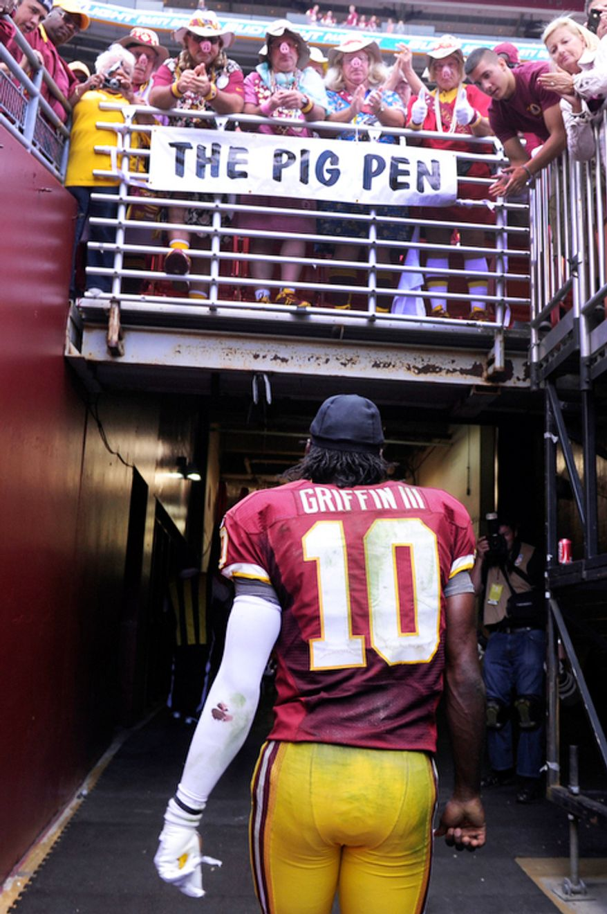 Washington Redskins quarterback Robert Griffin III (10) walks off the field after losing to the Bengals 38-31 at FedEx Field, Landover, Md., Sep. 23, 2012. (Preston Keres/Special to The Washington Times)