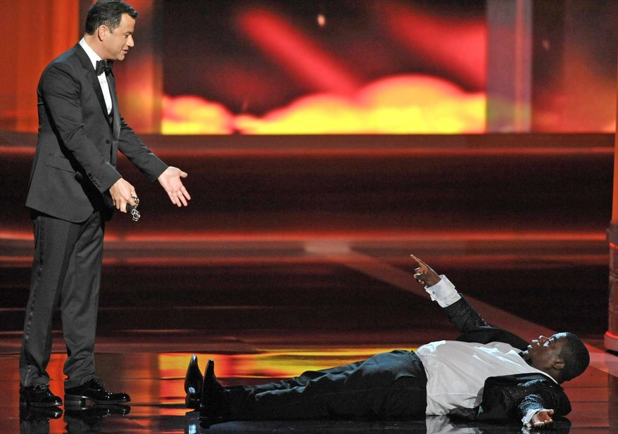 Emmys telecast host Jimmy Kimmel (left) and actor-comedian Tracy Morgan perform at the 64th Primetime Emmy Awards on Sunday night. The two had conspired to start a rumor that Mr. Morgan had passed out on stage. (Associated Press)