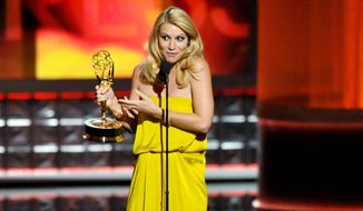 "Claire Danes accepts the award for outstanding lead actress in a drama series for ""Homeland"" at the 64th Primetime Emmy Awards at the Nokia Theatre on Sunday, Sept. 23, 2012, in Los Angeles. (Invision via Associated Press)"