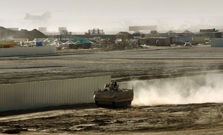 **FILE** An armored vehicle patrols the periphery of Camp Bastion in southern Afghanistan in January 2007. (Associated Press)