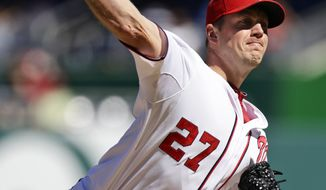 Washington Nationals starting pitcher Jordan Zimmermann throws during the second inning of a baseball game against the Milwaukee Brewers at Nationals Park, Monday, Sept. 24, 2012, in Washington. (AP Photo/Alex Brandon)