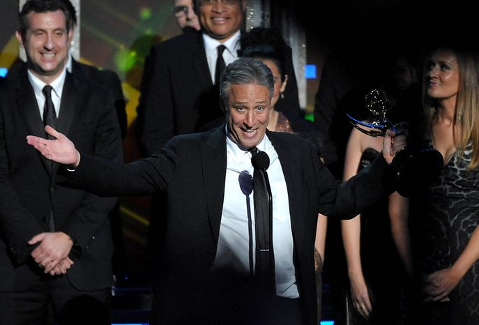 """Jon Stewart accepts the award for Outstanding Variety Series for """"The Daily Show With Jon Stewart"""" at the 64th Primetime Emmy Awards at the Nokia Theatre on Sunday, Sept. 23, 2012, in Los Angeles. (John Shearer/Invision/AP)"""