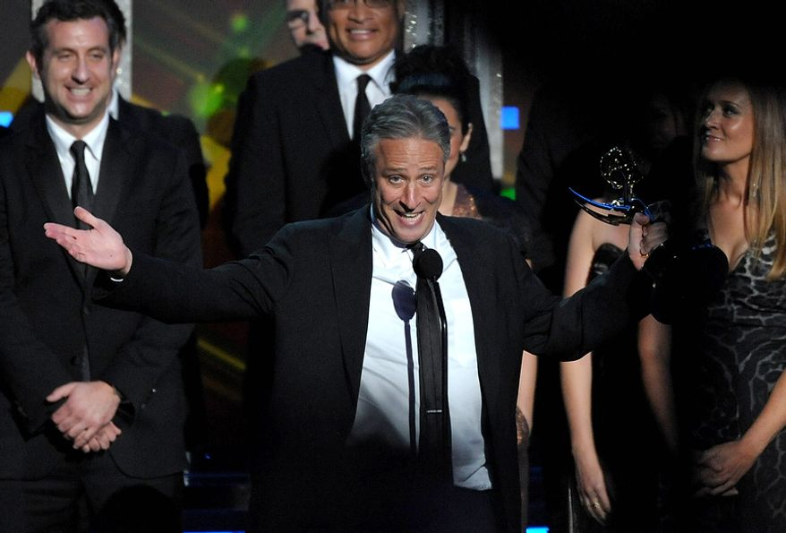 "Jon Stewart accepts the award for Outstanding Variety Series for ""The Daily Show With Jon Stewart"" at the 64th Primetime Emmy Awards at the Nokia Theatre on Sunday, Sept. 23, 2012, in Los Angeles. (John Shearer/Invision/AP)"