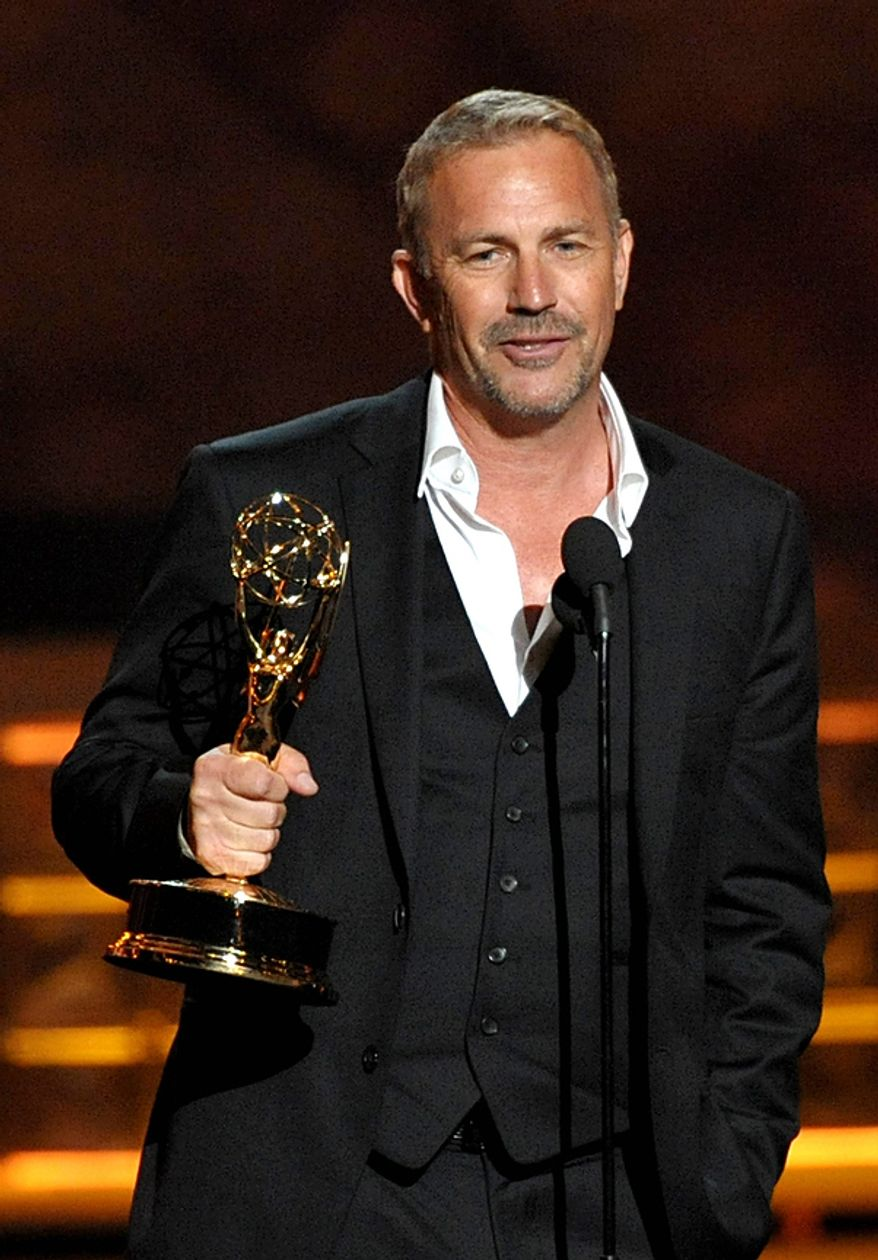 """Kevin Costner accepts the award for Outstanding Lead Actor in a Miniseries or Movie for """"Hatfields & McCoys"""" at the 64th Primetime Emmy Awards at the Nokia Theatre on Sunday, Sept. 23, 2012, in Los Angeles. (John Shearer/Invision/AP)"""