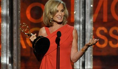 """Jessica Lange accepts the award for Outstanding Supporting Actress in a Miniseries for """"American Horror Story"""" at the 64th Primetime Emmy Awards at the Nokia Theatre on Sunday, Sept. 23, 2012, in Los Angeles. (John Shearer/Invision/AP)"""