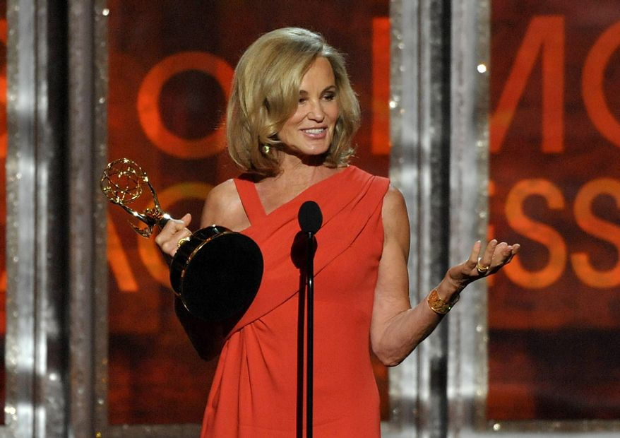 "Jessica Lange accepts the award for Outstanding Supporting Actress in a Miniseries for ""American Horror Story"" at the 64th Primetime Emmy Awards at the Nokia Theatre on Sunday, Sept. 23, 2012, in Los Angeles. (John Shearer/Invision/AP)"