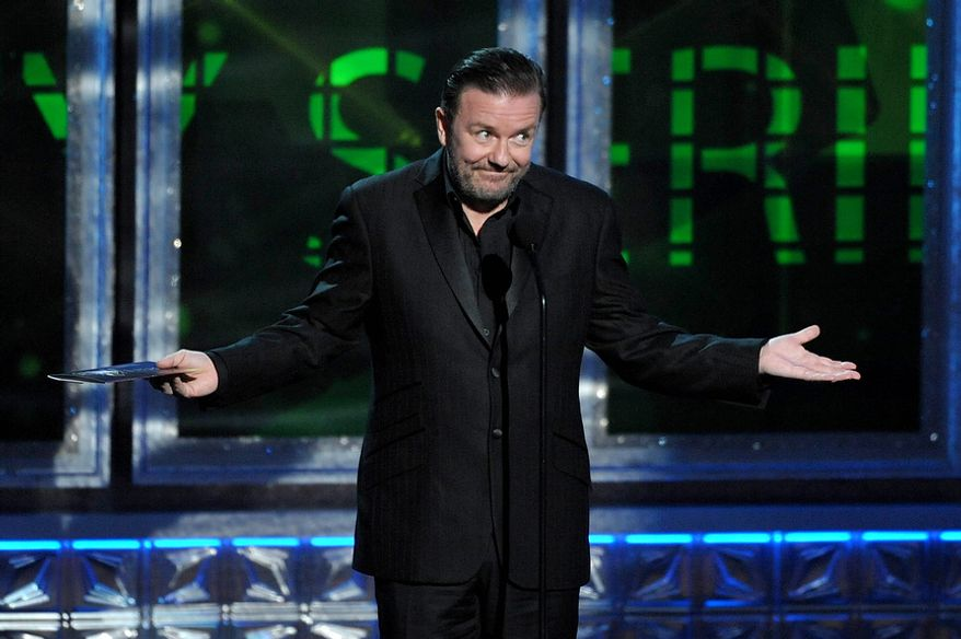 Ricky Gervais presents an award at the 64th Primetime Emmy Awards at the Nokia Theatre on Sunday, Sept. 23, 2012, in Los Angeles. (John Shearer/Invision/AP)