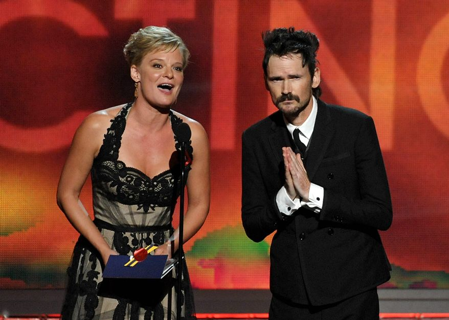 Martha Plimpton, left, and Jeremy Davies present an award onstage at the 64th Primetime Emmy Awards at the Nokia Theatre on Sunday, Sept. 23, 2012, in Los Angeles. (Photo by John Shearer/Invision/AP)