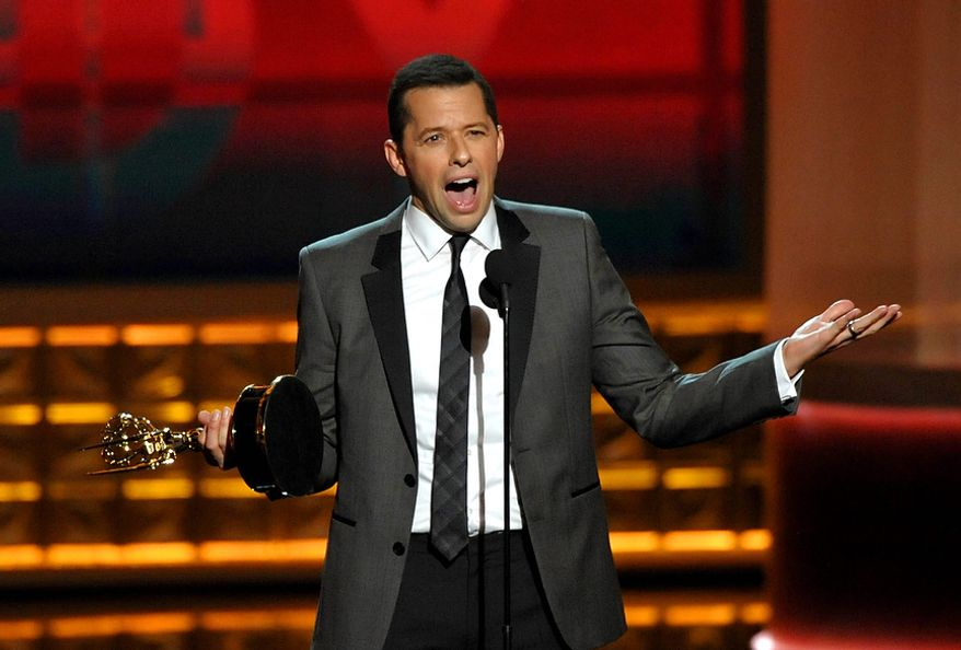 "Jon Cryer accepts the award for Outstanding Lead Actor in a Comedy Series for ""Two and a Half Men"" at the 64th Primetime Emmy Awards at the Nokia Theatre on Sunday, Sept. 23, 2012, in Los Angeles. (John Shearer/Invision/AP)"
