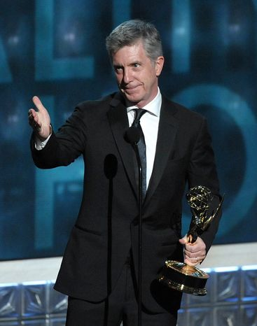 """Tom Bergeron accepts the award for Outstanding Host for a Reality or Reality-Competition Program for """"Dancing With the Stars"""" at the 64th Primetime Emmy Awards at the Nokia Theatre on Sunday, Sept. 23, 2012, in Los Angeles. (John Shearer/Invision/AP)"""