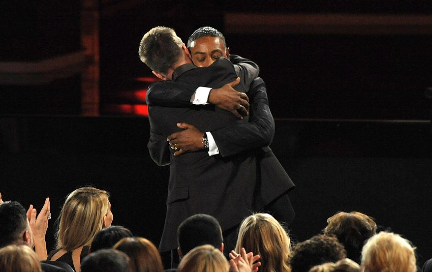 "Giancarlo Esposito (right) congratulates Aaron Paul after Mr. Paul won the award for Outstanding Supporting Actor in a Drama Series for ""Breaking Bad"" at the 64th Primetime Emmy Awards at the Nokia Theatre on Sunday, Sept. 23, 2012, in Los Angeles. (John Shearer/Invision/AP)"