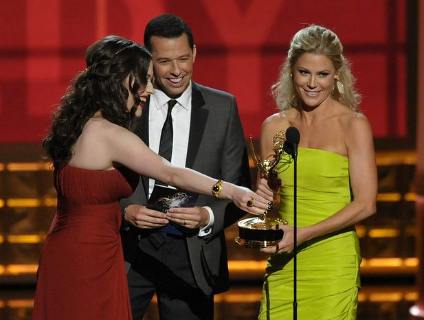 "Kat Dennings (left) and Jon Cryer (center) present the award for Outstanding Supporting Actress in a Comedy Series to Julie Bowen for ""Modern Family"" at the 64th Primetime Emmy Awards at the Nokia Theatre on Sunday, Sept. 23, 2012, in Los Angeles. (John"