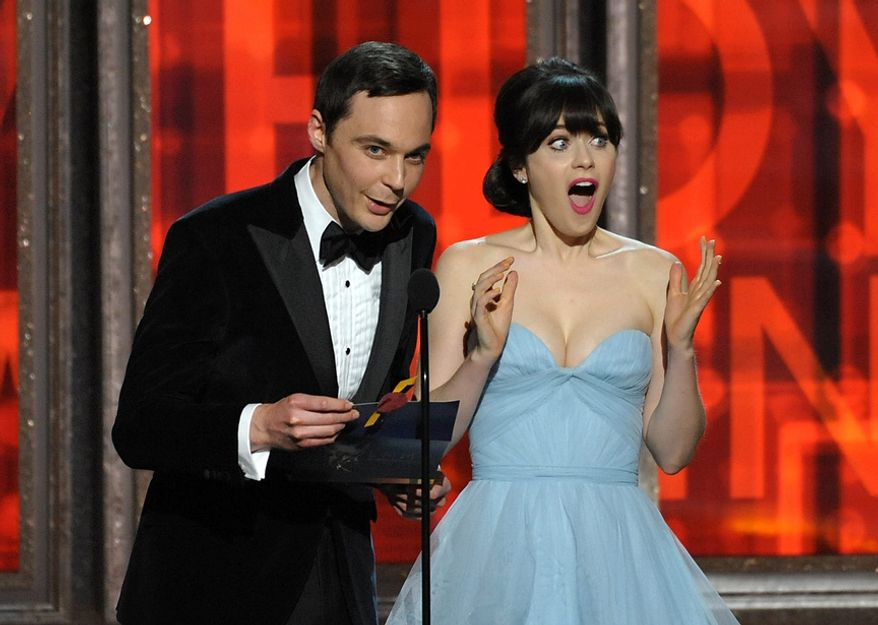 Jim Parsons and Zooey Deschanel present an award onstage at the 64th Primetime Emmy Awards at the Nokia Theatre on Sunday, Sept. 23, 2012, in Los Angeles. (John Shearer/Invision/AP)