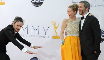 Actor Jeremy Davies, left, actress Leslie Mann and director Judd Apatow, right, arrive at the 64th Primetime Emmy Awards at the Nokia Theatre on Sunday, Sept. 23, 2012, in Los Angeles.  (Photo by Jordan Strauss/Invision/AP)