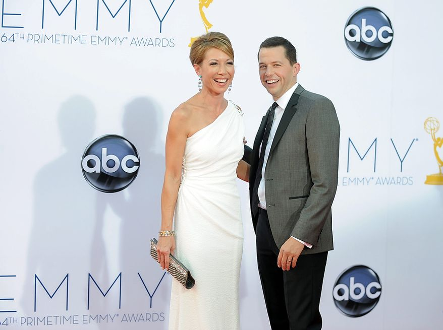 Actor Jon Cryer, right and wife Lisa Joyner arrive at the 64th Primetime Emmy Awards at the Nokia Theatre on Sunday, Sept. 23, 2012, in Los Angeles.  (Photo by Jordan Strauss/Invision/AP)