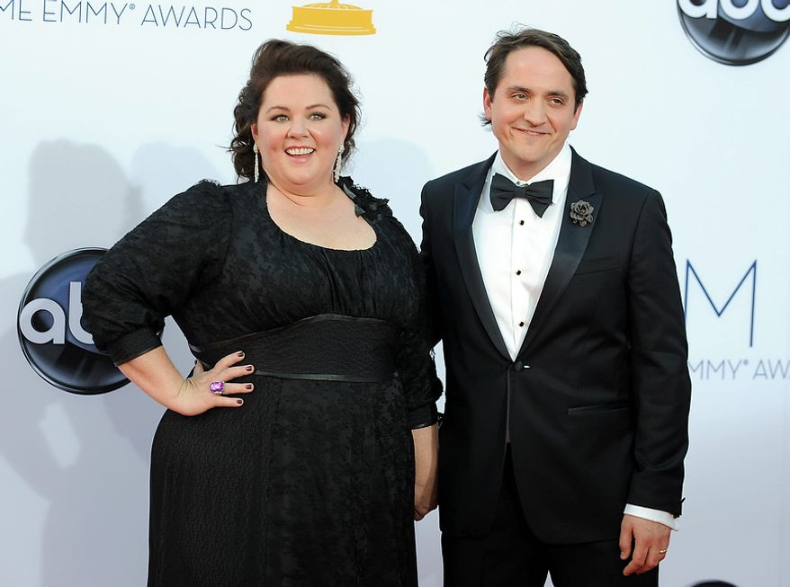 Actress Melissa McCarthy, left and actor Ben Falcone arrive at the 64th Primetime Emmy Awards at the Nokia Theatre on Sunday, Sept. 23, 2012, in Los Angeles. (Photo by Matt Sayles/Invision/AP)