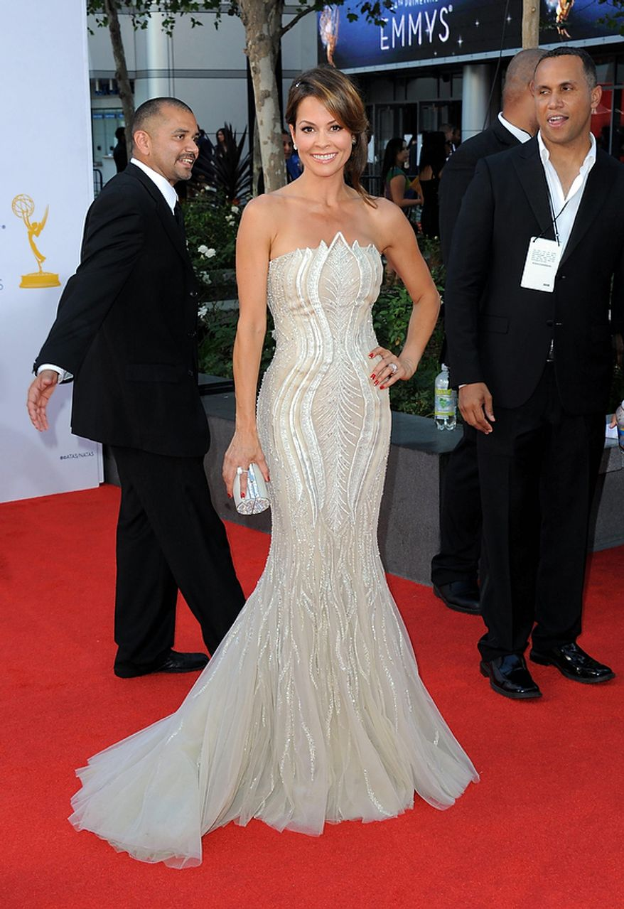 "TV personality Brooke Burke from ""Dancing with the Stars,"" arrives at the 64th Primetime Emmy Awards at the Nokia Theatre on Sunday, Sept. 23, 2012, in Los Angeles.  (Photo by Jordan Strauss/Invision/AP)"