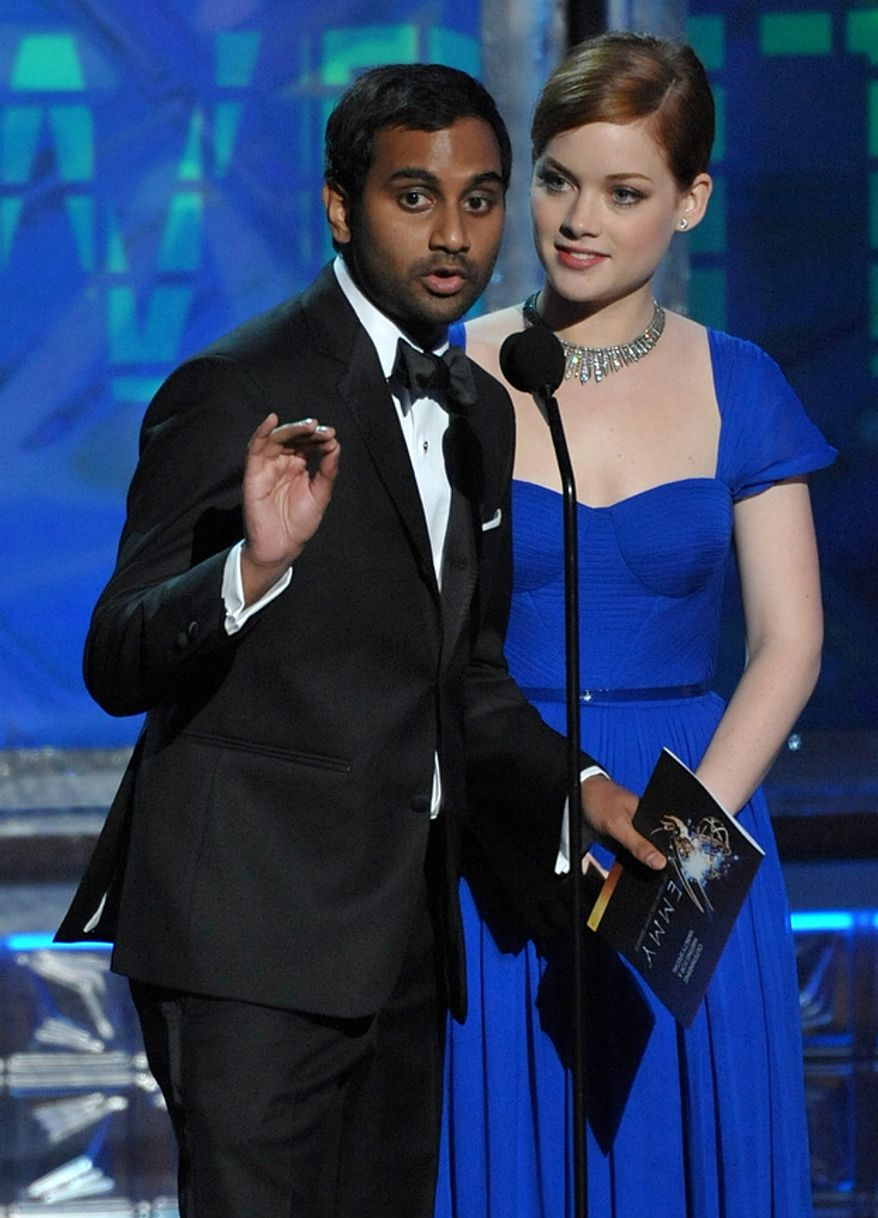Aziz Ansari, left, and Jane Levy present an award onstage at the 64th Primetime Emmy Awards at the Nokia Theatre on Sunday, Sept. 23, 2012, in Los Angeles. (Photo by John Shearer/Invision/AP)