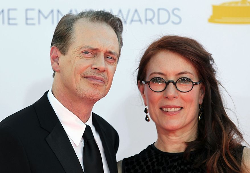 Actor Steve Buscemi, left and wife Jo Andres arrive at the 64th Primetime Emmy Awards at the Nokia Theatre on Sunday, Sept. 23, 2012, in Los Angeles. (Photo by Matt Sayles/Invision/AP)
