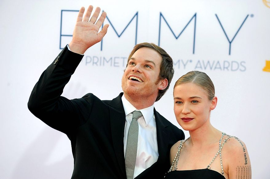 Actor Michael C. Hall, left and Morgan Macgregor arrive at the 64th Primetime Emmy Awards at the Nokia Theatre on Sunday, Sept. 23, 2012, in Los Angeles. (Photo by Matt Sayles/Invision/AP)
