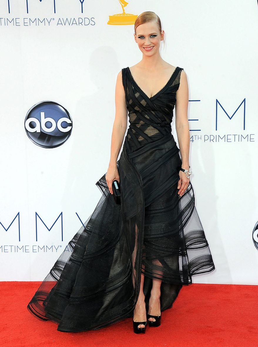 Actress January Jones arrives at the 64th Primetime Emmy Awards at the Nokia Theatre on Sunday, Sept. 23, 2012, in Los Angeles.  (Photo by Jordan Strauss/Invision/AP)