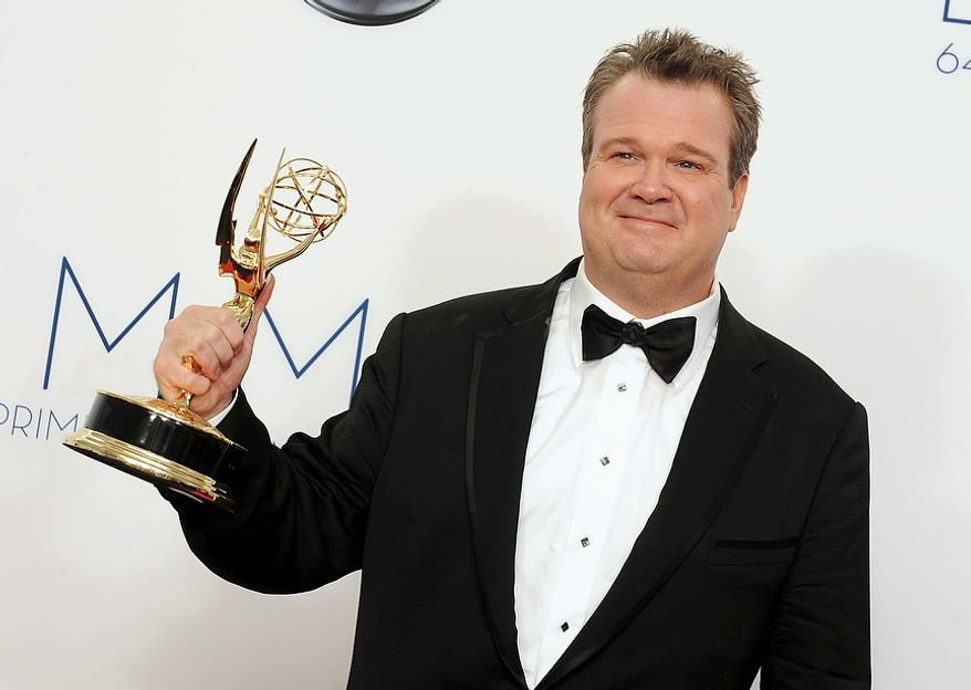 "Eric Stonestreet poses backstage with his award for best supporting actor in a comedy series for ""Modern Family"" at the 64th Primetime Emmy Awards at the Nokia Theatre on Sunday, Sept. 23, 2012, in Los Angeles. (Photo by Jordan Strauss/Invision/AP)"