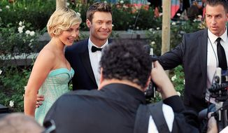 Actress Julianne Hough (left) and TV personality Ryan Seacrest arrive at the 64th Primetime Emmy Awards at the Nokia Theatre on Sunday, Sept. 23, 2012, in Los Angeles. (Jordan Strauss/Invision/AP)