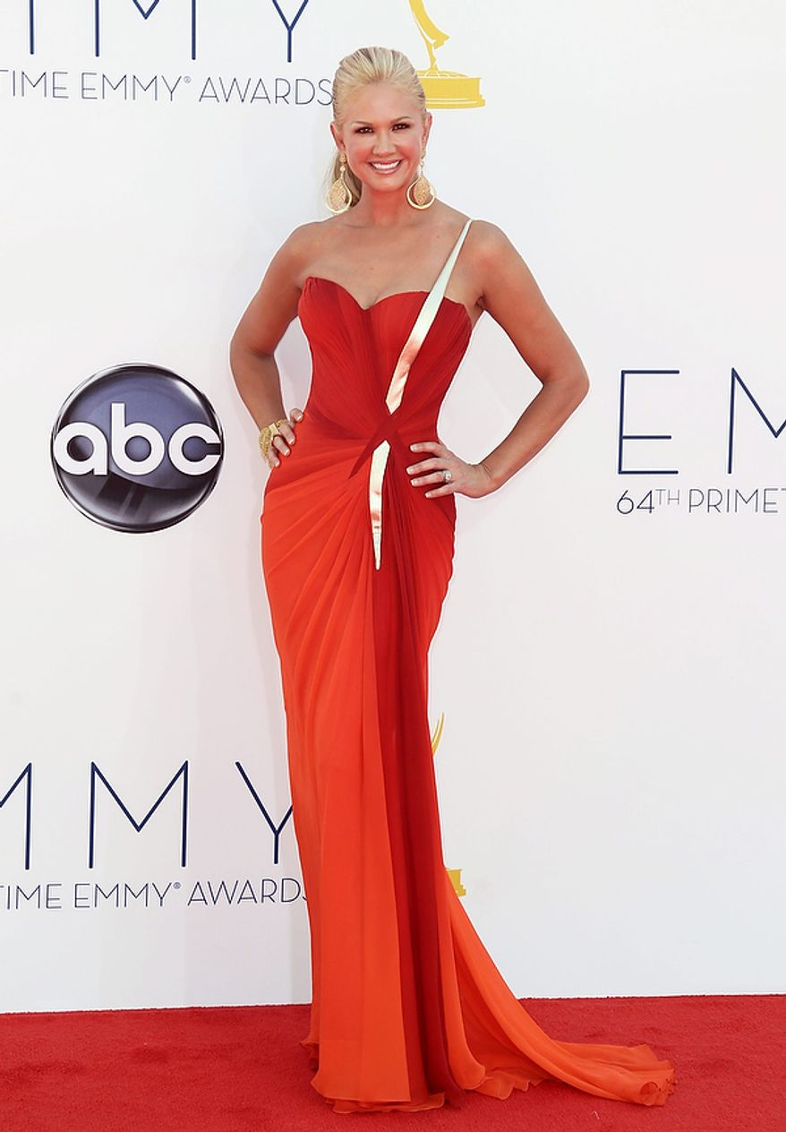Nancy O'Dell arrives at the 64th Primetime Emmy Awards at the Nokia Theatre on Sunday, Sept. 23, 2012, in Los Angeles. (Photo by Matt Sayles/Invision/AP)